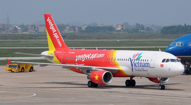"""vietjet chinh thuc """"soan ngoi"""" vietnam airlines hinh anh 1"""